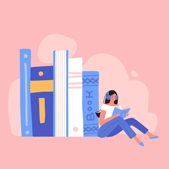 Jonge vrouw zit in de buurt van een stapel boeken met een koptelefoon op haar hoofd audioboek concept boeken lezen...