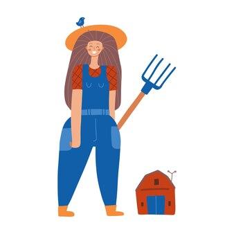 Jonge vrouwelijke boer in uniform met hooivork vrouw beroep geïsoleerd vrouwelijk karakter met schuur