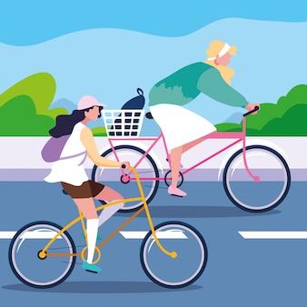 Jonge vrouwen die fiets in de weg berijden
