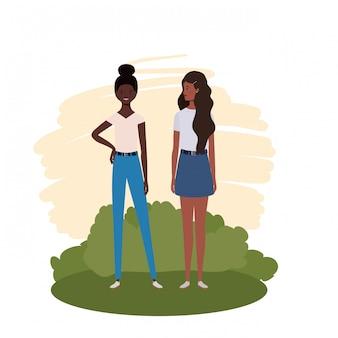 Jonge vrouwen die zich met landschap bevinden