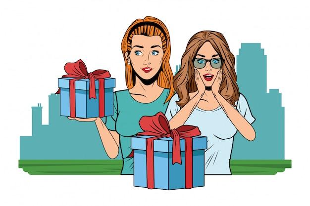 Jonge vrouwen met een pop-art geschenkdoos