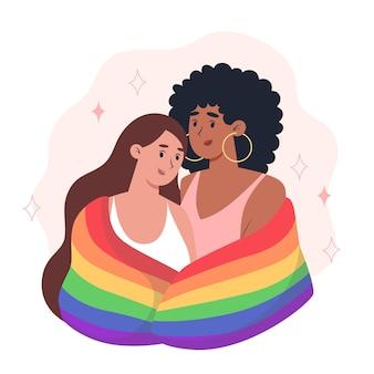 Jonge vrouwen omhelzen elkaar en houden een regenboog lgbt-trotsvlag vast
