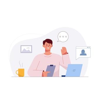 Jonge zakenman die laptop gebruikt, praat met collega tijdens een videogesprek terwijl hij thuis werkt