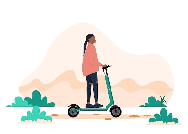 Jonge zwarte vrouwelijke vrouw die een elektrische autoped berijdt. stedelijk vervoer. moderne technologieën. actieve jonge volwassenen.