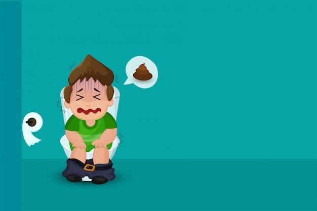 Jongen die aan constipatie op het toilet lijdt.
