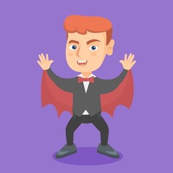 Jongen die een vampierkostuum op halloween draagt.
