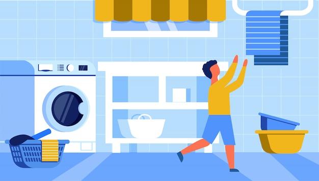 Jongen die handdoek van hanger in vlakke badkamers neemt