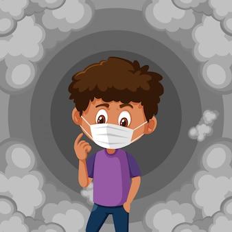 Jongen die masker en vuile rook draagt