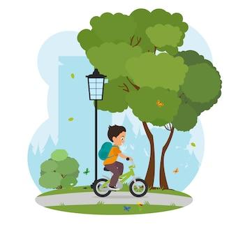 Jongen die zijn fiets van school naar huis leert te berijden