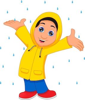 Jongen draagt regenjas geïsoleerd op wit