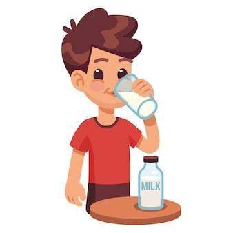 Jongen drinkt melk. jong geitjeholding en consumptiemelk in glas.