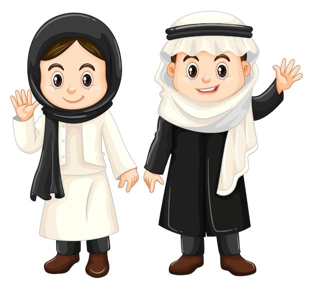 Jongen en meisje in koeweit-kostuums
