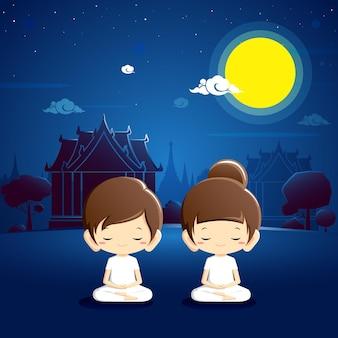Jongen en meisje in witte kleding die bij tempel met nachtscène mediteren