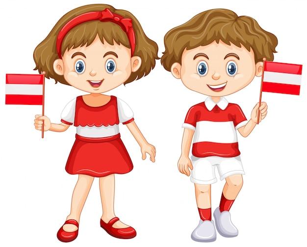 Jongen en meisje met de vlag van oostenrijk
