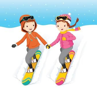 Jongen en meisje snowboarden, hand in hand samen, vallende sneeuw, winterseizoen