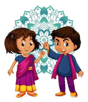 Jongen en meisje uit india met mandala