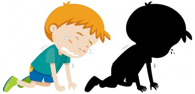 Jongen huilen op de vloer met zijn silhouet