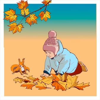 Jongen in herfstkleren spelen op de grond met gele herfstbladeren. kaart met kleurrijke herfst elementen.