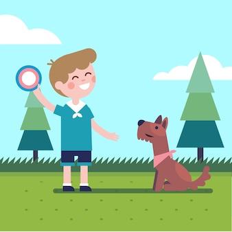 Jongen jongen spelen vliegende schijf trow vangen met een hond