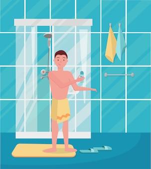 Jongen kwam uit de douche. gelukkig man onder de douche. man die in de badkamer staat.