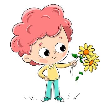 Jongen met bloemen die hen aan iemand geven. aanbiddelijke jongen met rood haar en krullend haar.