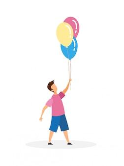 Jongen met opblaasbare ballonnen
