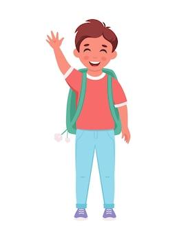 Jongen met rugzak die naar school gaat jongen lacht en zwaait met de hand basisschoolstudent