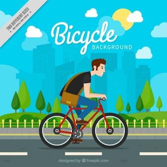 Jongen met zijn fiets achtergrond