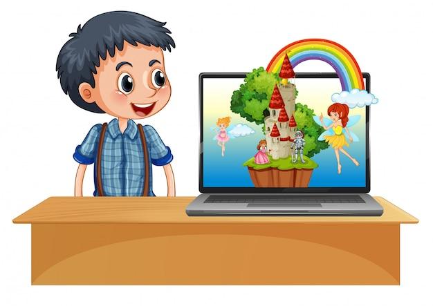 Jongen naast laptop met fee op backgroung