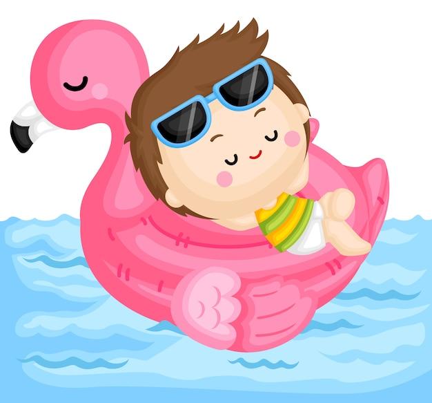 Jongen op flamingo float