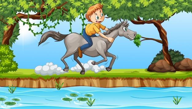 Jongen rijdt op een paard