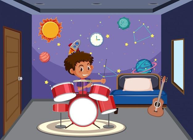 Jongen speeltrommel in de slaapkamer