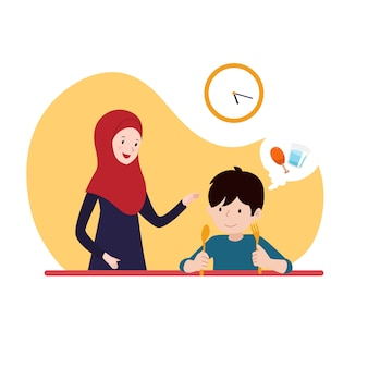 Jongen wacht op iftar time-break vasten met zijn moeder dragen hijab. familie ramadan activiteit