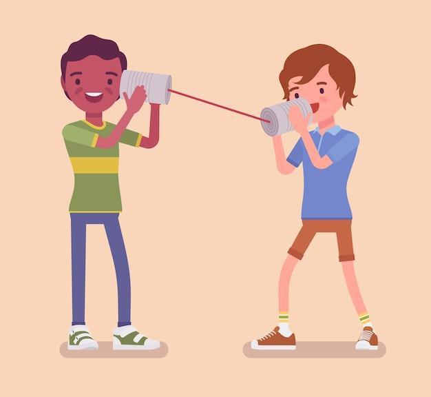 Jongens spreken via een blikje telefoon