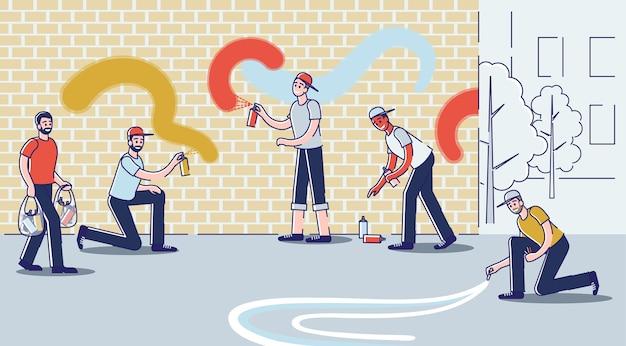 Jongens tekenen graffiti op de muur jonge graffitikunstenaars die straatkunst maken