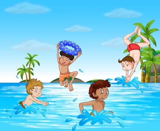 Jongens zwemmen en duiken in de zee