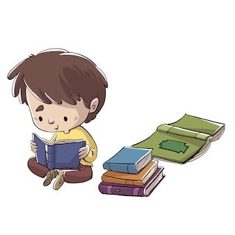 Jongenszitting op de vloer die een boek leest