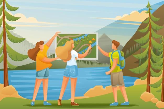 Jongeren bestuderen een kaart op het meer in het bos, kamperen