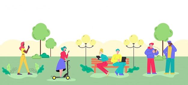 Jongeren die gadgets in het park gebruiken