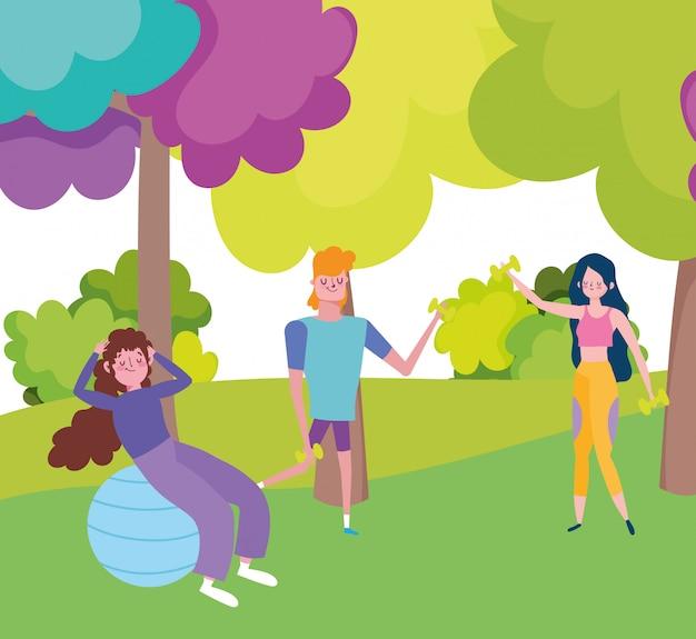 Jongeren met dummbells en fitball in het park