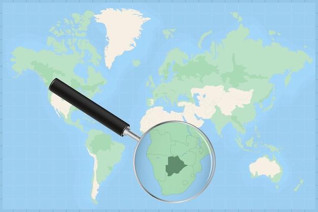 Kaart van de wereld met een vergrootglas op een kaart van botswana.