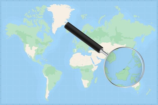 Kaart van de wereld met een vergrootglas op een kaart van brunei.