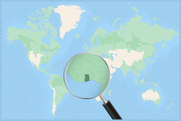 Kaart van de wereld met een vergrootglas op een kaart van ghana.