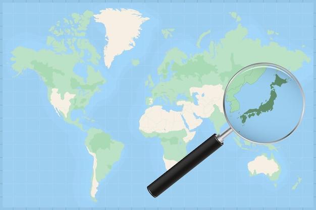 Kaart van de wereld met een vergrootglas op een kaart van japan.
