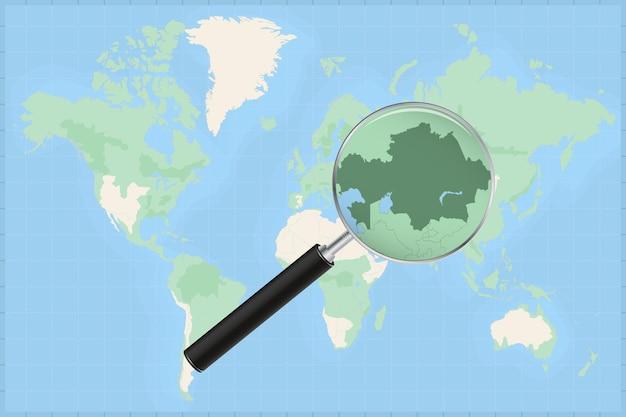 Kaart van de wereld met een vergrootglas op een kaart van kazachstan.