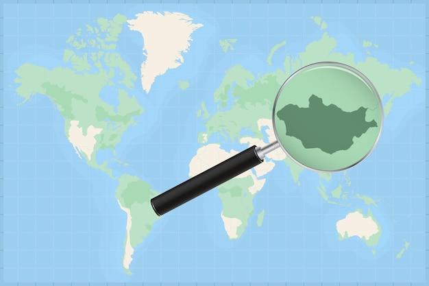Kaart van de wereld met een vergrootglas op een kaart van mongolië.