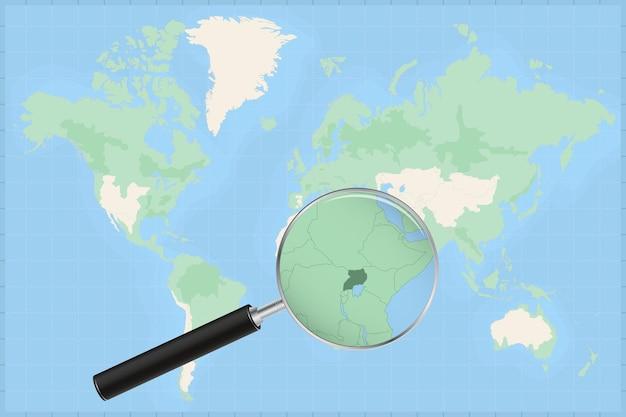 Kaart van de wereld met een vergrootglas op een kaart van oeganda.
