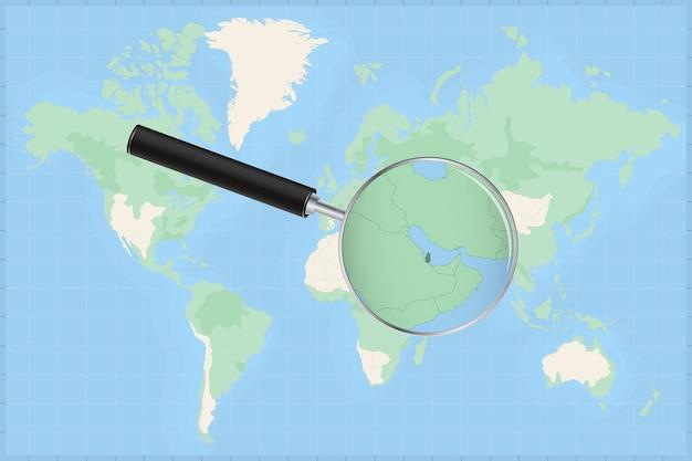 Kaart van de wereld met een vergrootglas op een kaart van qatar.