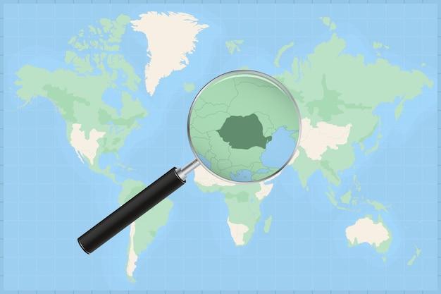 Kaart van de wereld met een vergrootglas op een kaart van roemenië.