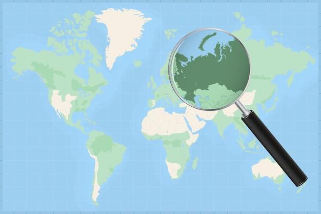 Kaart van de wereld met een vergrootglas op een kaart van rusland